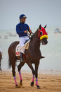 Horse race on sanlucar of barrameda spain august de cadiz unidentified rider at the start horses de beach Stock Photo