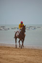 Horse race on sanlucar of barrameda spain de cadiz august unidentified rider at the start horses de beach august Stock Images