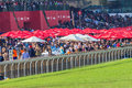 Horse racing final straight betting public green grass towards the finish line and venue event the durban july at greyville Royalty Free Stock Photo
