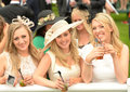 Horse racing girls watching the from the silver ring at ascot Royalty Free Stock Photography