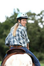 Horse rider looking back Royalty Free Stock Photo