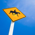 Horse rider warning road sign against blue sky Stock Photography