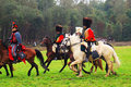 Horse riders reenactors dressed as napoleonic war soldiers ride horses at borodino historical reenactment battle at its th Royalty Free Stock Photography