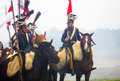 Horse riders reenactors dressed as napoleonic war soldiers ride horses at borodino historical reenactment battle at its th Stock Photography