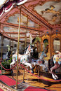 Horse rides on merry go round carousel a Stock Photography