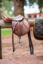 Horse saddle hanging on a wooden stand Stock Photography