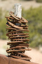 Horse Shoes Stacked on Fence Post
