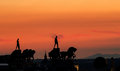 Horse silhouette over madrid two equestrian sculptures with chariot on a rooftop at sunset Stock Photography