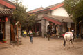 Horse walk in evening shuhe ancient town lijiang china march walking around for tourists service on march is the old lijiang Royalty Free Stock Image