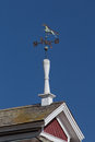 Horse weather vane on top of barn vertical image in united states Royalty Free Stock Photos