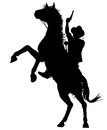 Horseback cowboy editable vector silhouette of a shooting a pistol on a rearing horse Stock Photography