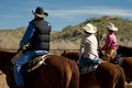 Horseback riding in the desert vacationers from a dude guest ranch go for a ride arizona Royalty Free Stock Photos