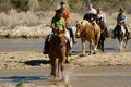 Horseback riding in the desert vacationers from a dude guest ranch go for a ride arizona Stock Photos