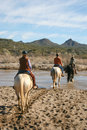 Horseback riding in the desert vacationers from a dude guest ranch go for a ride arizona Stock Photo