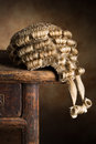 Horsehair judge wig real lawyer s on an antique wooden desk Stock Images