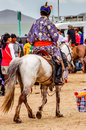 Horseman in traditional deel nadaam horse race mongolia khui doloon khudag july horseback spectator wearing tunic called a Royalty Free Stock Image