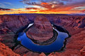 Horseshoe bend dramatic of the colorado river at the close to the city of page arizona usa picture taken shortly after sunset Stock Images