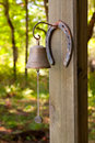 Horseshoe and Dinner Bell Royalty Free Stock Photo