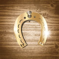 Horseshoe over wooden background Royalty Free Stock Photos