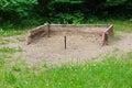 Horseshoe stakes in a sandbox area Royalty Free Stock Photo