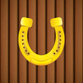 Horseshoe on a wooden background vector Royalty Free Stock Images
