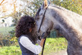 horsewoman kisses his horse to the country Royalty Free Stock Photo