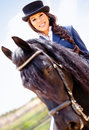 Horsewoman riding a horse Royalty Free Stock Photography