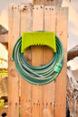 Hoses are rolled up in storage which in garden Stock Photos