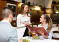 Hospitable waitress taking order Royalty Free Stock Photo