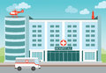 Hospital building with Medical helicopter and ambulance. Royalty Free Stock Photo
