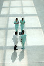 Hospital hall medical professionals walking down hallway Stock Images