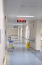 Hospital hallway with clock and nursing garden cart Royalty Free Stock Photo
