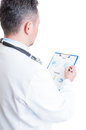 Hospital manager reading financial charts and sales prediction for pills Stock Image