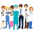 Hospital medical team group made of doctors nurses and surgeon standing smiling with arms crossed Royalty Free Stock Photography