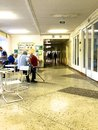 Hospital patients at lunch. They sit at the tables in the corridor of the clinic. Royalty Free Stock Photo
