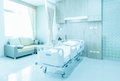 Hospital room with beds and comfortable medical equipped in a mo Royalty Free Stock Photo