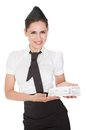 Hospitality hostess presenting a voucher Stock Photos