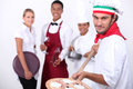 Hospitality workers posing for staff photo Royalty Free Stock Photography