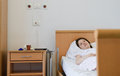 Hospitalized patient woman in hospital room Royalty Free Stock Images