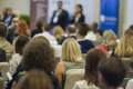 Host Speakers Standing in Front of the Audience During the Conference. Royalty Free Stock Photo