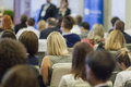 Host Speakers Talking in Front of the Audience During the Conference Royalty Free Stock Photo