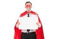 Hostage in superhero costume holding blank banner isolated on white background Stock Image