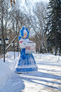 Hostess of municipal park large sculpture maiden on a snow covered alley in the city Stock Image