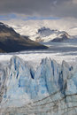 Hostile glacier peaks from perito moreno in front of mountain chain one the still growning the world argentina Stock Image