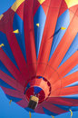 Hot air ballon a red in front of a shiny blue sky Royalty Free Stock Photo