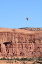 Hot air balloon above sandstone mesa near moab utah Stock Photo