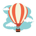 Hot air balloon a against a cloudy sky Royalty Free Stock Images