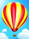 Hot air balloon on the blue sky Stock Photography