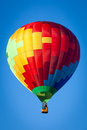 Hot air balloon on blue sky Stock Photography