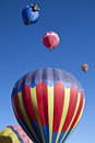 Hot air balloon in the blue sky albuquerque new mexico festival several colorful balloons against clear Stock Photo